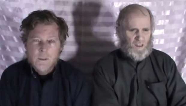Timothy Weeks and Kevin King speak to the camera while kept hostage by Taliban insurgents in an unkn