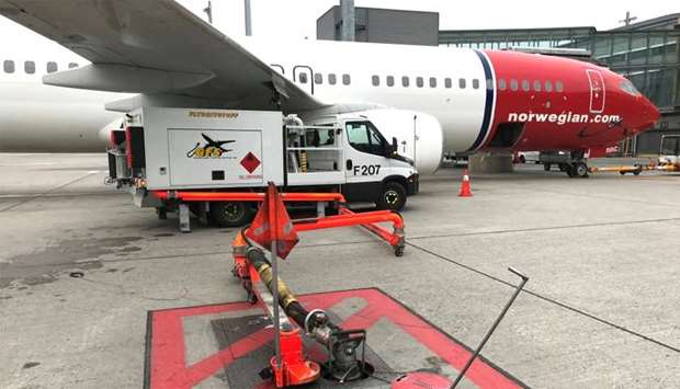 A Norwegian Air plane is refuelled at Oslo Gardermoen airport, Norway
