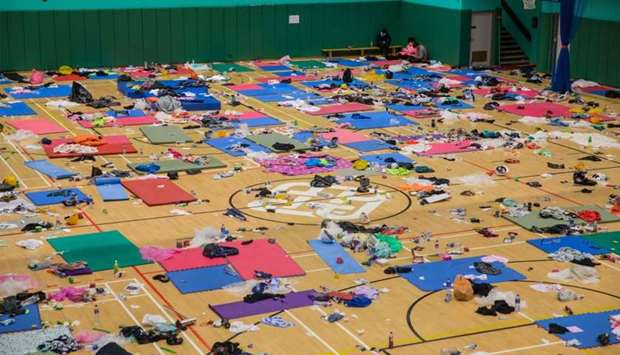 Protesters rest inside a sports hall at Hong Kong Polytechnic University in the Hung Hom district in
