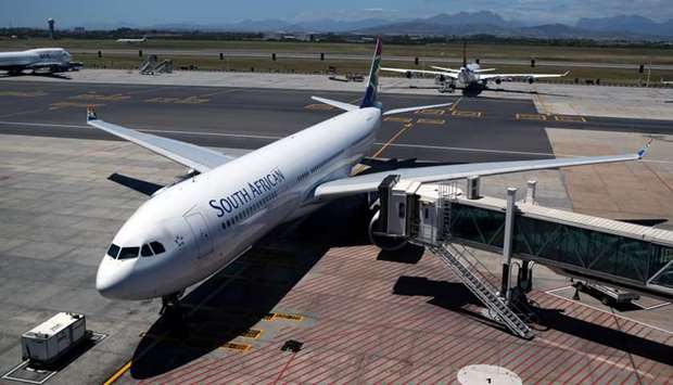 A South African Airways (SAA) aircraft is seen parked on the tarmac at Cape Town International Airpo