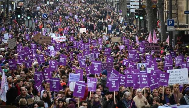 People take part in a protest to condemn violence against women in Paris