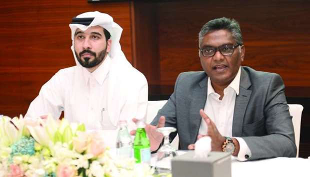 Narendra Kumar, who heads the summit's Steering Committee; and Mahmoud al-Mohmmedi, Qatar Trade Summ