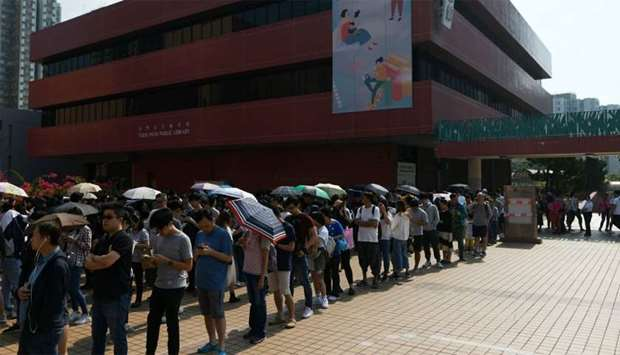 People queue to cast their vote during the district council elections in Tuen Mun district of Hong K