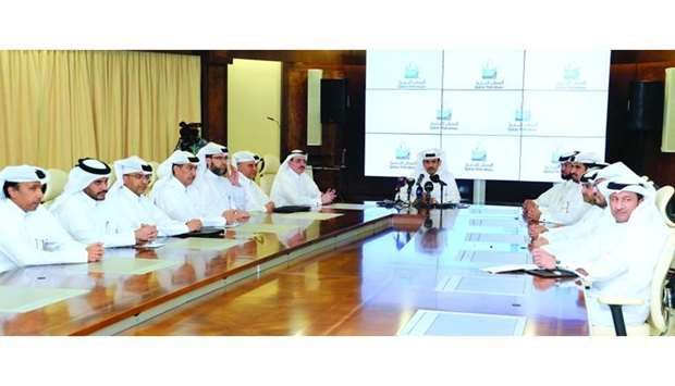 HE al-Kaabi with QP's senior management team announcing Qatar's LNG production boost to 126mn tonnes