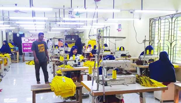 Women were provided sewing machines by Qatar Charity.