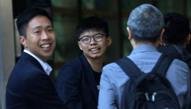 Winning candidate Kelvin Lam and activist Joshua Wong greet people and thank them for their support,