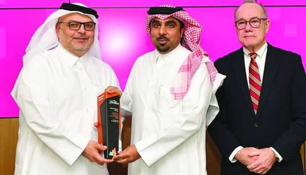 QF's Ghanim al-Ibrahim receiving the first position award for Qatar National Library Project as Ashg