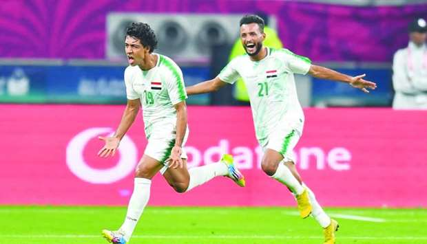 Iraq's Mohamed Qasem (left) celebrates after scoring a goal against Qatar during the Arabian Gulf Cu