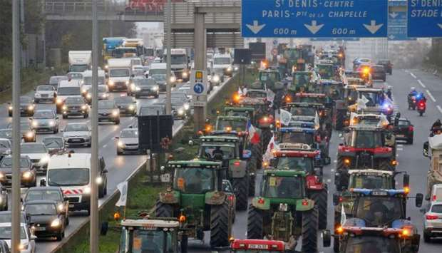 French farmers drive their tractors on the A1 Lille-Paris motorway near Le Bourget on their way to P