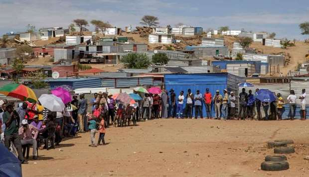 Namibians wait in line to access a polling station during the Namibian Presidential and parliamentar