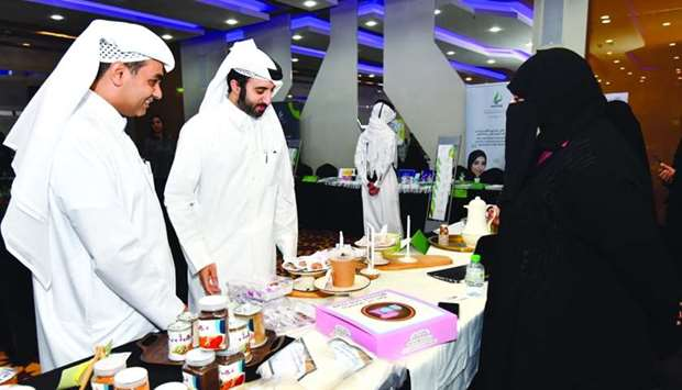 Al Meera IT director Mohamed al-Bader (left) viewing the products on display during the event held a