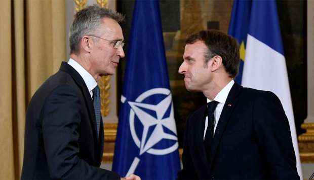 NATO Secretary General Jens Stoltenberg and French President Emmanuel Macron shake hands at the end