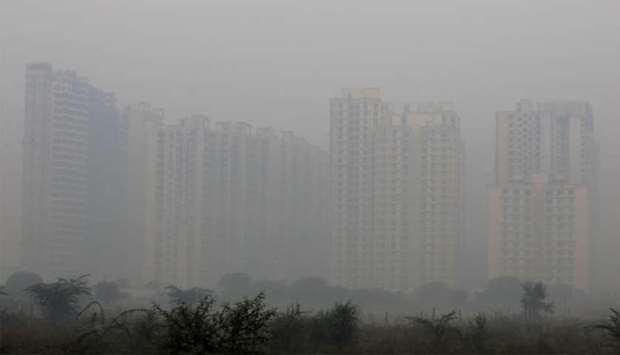 Buildings are engulfed in fog in Noida on the outskirts of New Delhi