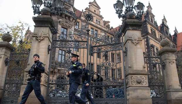 Policemen leave the Residenzschloss Royal Palace that houses the historic Green Vault (Gruenes Gewoe