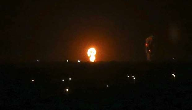 A ball of fire is seen following an Israel airstrike in Khan Yunis in the southern Gaza Strip early