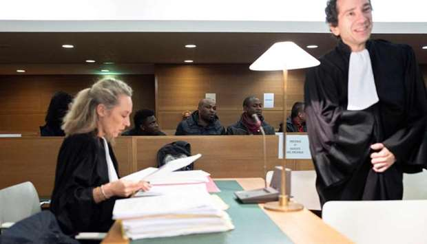 Nigerians defendants attending the start of a trial of a prostitution network case in Lyon, central