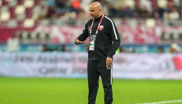 Qatar's coach Felix Sanchez Bas speaks to his players