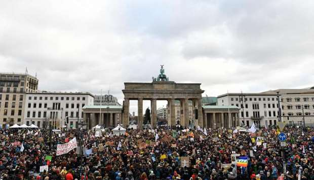 A general view shows demonstrators as they gather with placards in front of Brandenburg Gate during