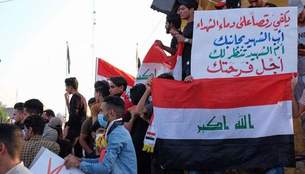 Iraqi protesters gather during ongoing anti-government demonstrations in the Shiite shrine city of K
