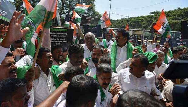 Activists hold placards abd Congress part flags during a protest called by Congress party and pro-fa