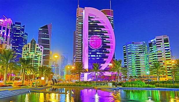 The Doha Bank Headquarters Tower lit up in pink.