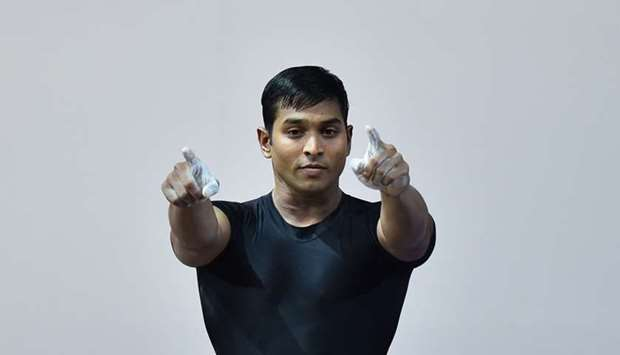 India's Ravi Kumar Katulu celebrates after a lift during the men's weightlifting 77kg class at the S