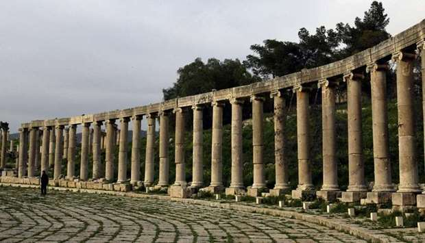 A file photo taken on April 2, 2003 shows a man walking amid the Roman columns of the ancient city o