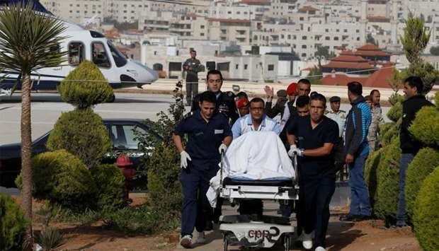 A tourist, who was injured in a stabbing, is brought into King Hussein Medical Center in Amman, Jord