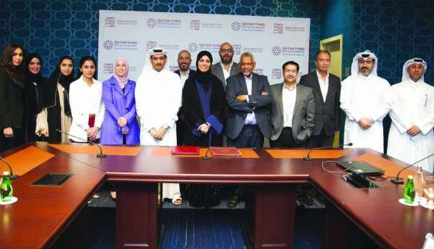 QFFD and Doha Institute for Graduate Studies officials at the agreement signing ceremony.