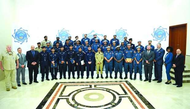 The officers pose for a group photo at the conclusion of the course.