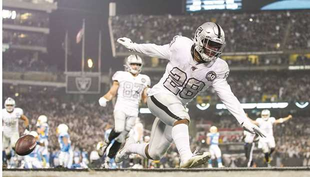 Oakland Raiders' Josh Jacobs scores the game-winning touchdown against the LA Chargers in Oakland, U