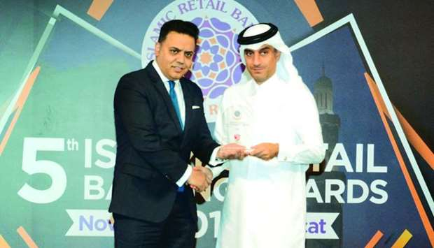 QIIB deputy CEO Jamal Abdullah al-Jamal (right) receiving the awards during a ceremony held in Musca