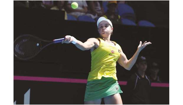 Ashleigh Barty hits a return against Caroline Garcia on day one of the Fed Cup Final in Perth yester