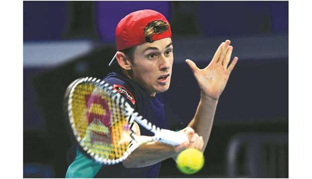 Alex de Minaur hits a return to Frances Tiafoe during their semi-final match of the ATP Finals at th