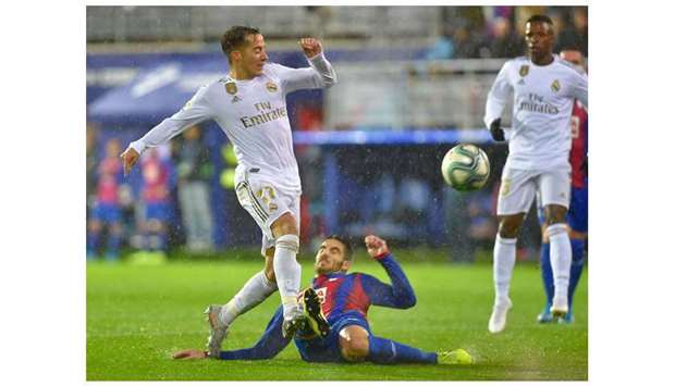 Real Madrid's Vazquez (left) vies for the ball with Eibar's Pedro Bigas during the La Liga match . A