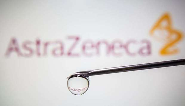AstraZeneca's logo is reflected in a drop on a syringe needle