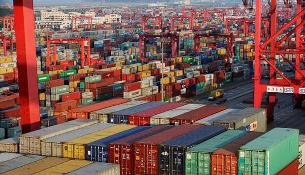 Container boxes are seen at the Yangshan Deep Water Port, part of the Shanghai Free Trade Zone, in S