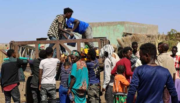 Ethiopians, who fled their homes due to ongoing fighting, are pictured at a refugee camp in the Hamd