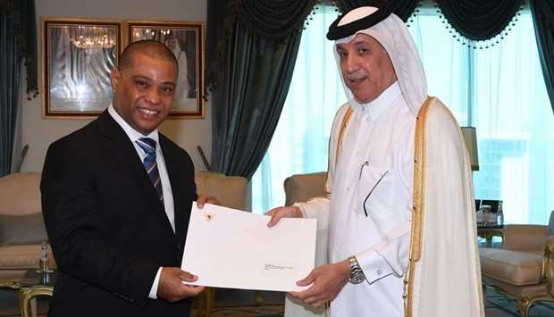 HE the Minister of State for Foreign Affairs Sultan bin Saad Al Muraikhi receives the copies of the