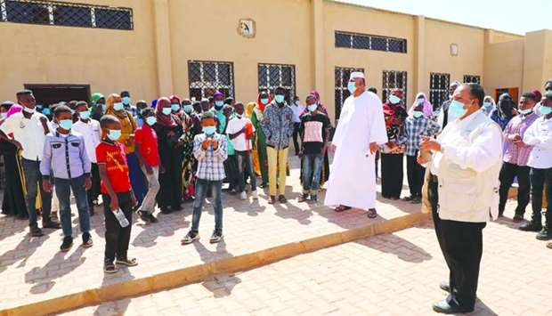 QC organises social day for students in Sudan