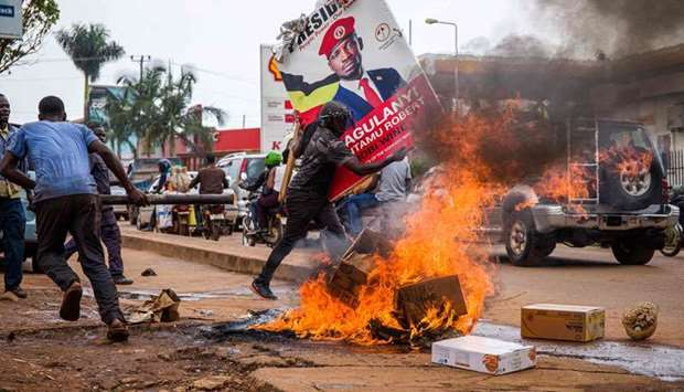 Ugandan police fired tear gas and rubber bullets at large crowds of protesters supporting popular pr