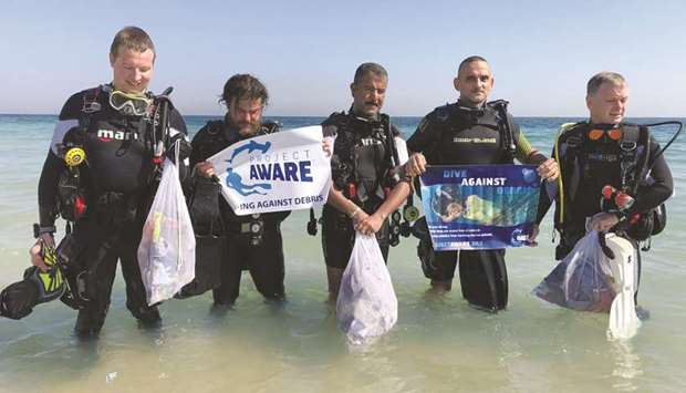 A group of underwater cleanup divers with Khaled Zaki (second right).