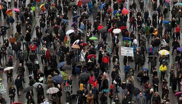 People wait for the start of a demonstration against the coronavirus Covid-19 restrictions in Munich