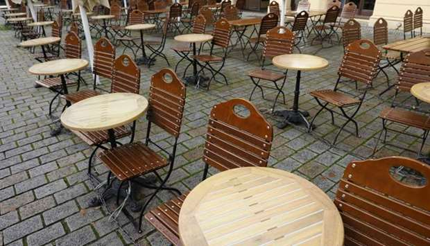 Tables and chairs are seen outside a closed cafe at Berlin's Hackescher Markt amid the novel coronav