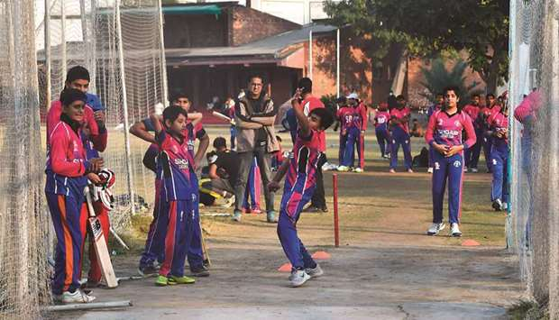 VOTE OF CONFIDENCE: Pakistani youth play cricket at a playground in Lahore. The return of England's