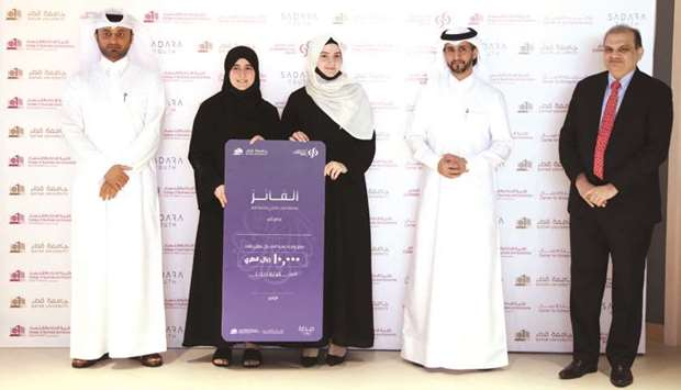 Winners Batool Alshaikh and Ola Hwari are joined by (from left) Commercial Bank AGM, head of Branche