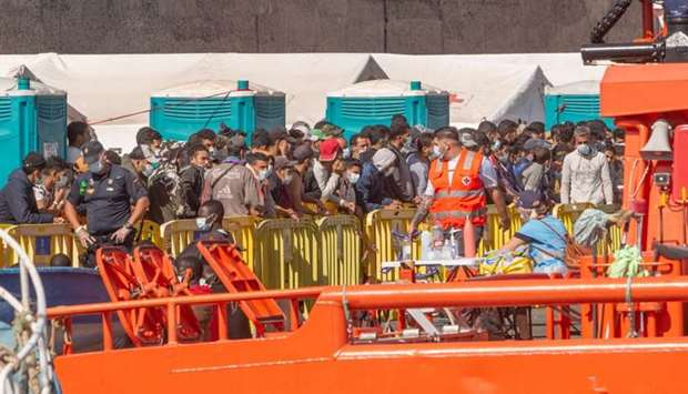 A group of migrants arrive at the Port of Arguineguin after being rescued by the Spanish coast guard