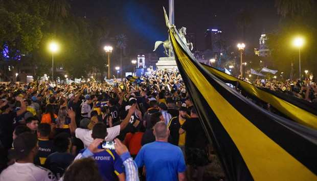 People gather outside the Casa Rosada presidential palace ahead of the wake of soccer legend Diego M