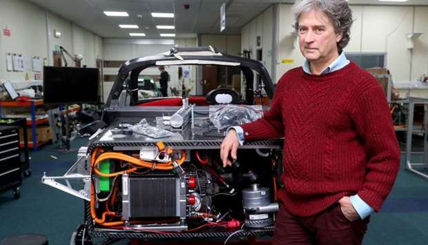Hugo Spowers, chief engineer and founder of Riversimple, poses for a photograph with one of his comp