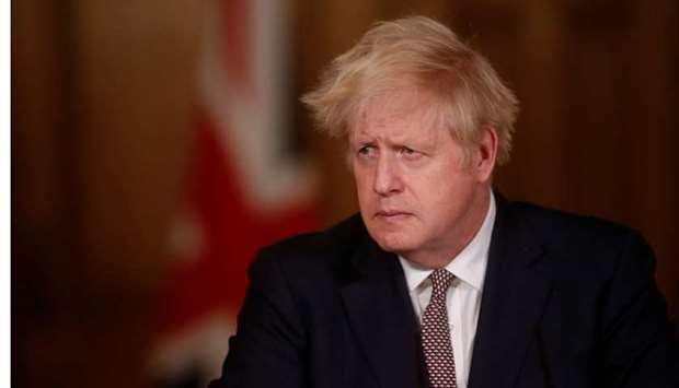 Britain's Prime Minister Boris Johnson attends a news conference on the ongoing situation with the c